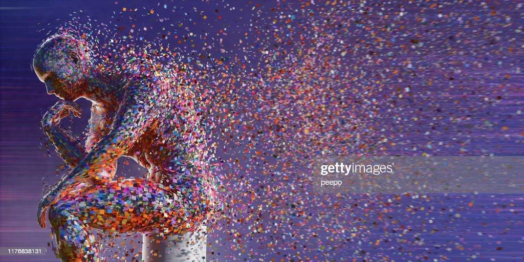 Figure abstraite formant des carrés multicolores s'asseyant dans la pose de pensée : Photo