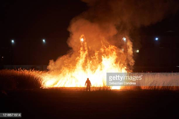 abstract firefighter in action on the field bushfire burning out of control. - アウトドアファイヤー ストックフォトと画像