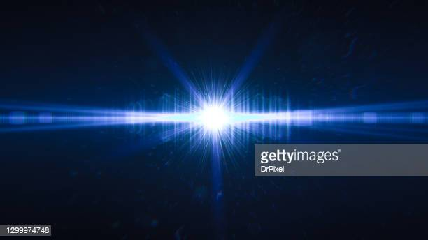 abstract flash light and defocused particles in the background - lens flare stock pictures, royalty-free photos & images