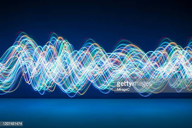 abstract flowing light trails - noise stock pictures, royalty-free photos & images