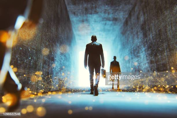abstract futuristic businessmen walking - light at the end of the tunnel stock pictures, royalty-free photos & images