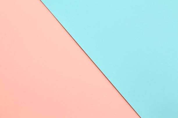 Abstract geometricpaper background in soft pastel pink and blue colors