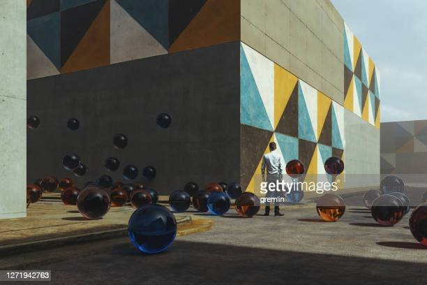 abstract glass sphere on the street - ball stock pictures, royalty-free photos & images