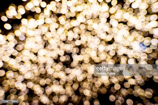 abstract gold bokeh with black background - bling bling stock pictures, royalty-free photos & images