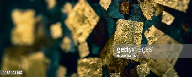 abstract, gold leaf background on a rusty metal surface. - gilded stock pictures, royalty-free photos & images
