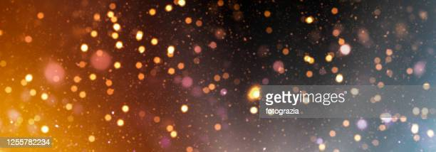 abstract golden defocused lights background - shiny stock pictures, royalty-free photos & images