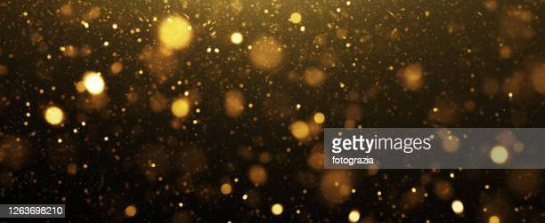 abstract golden defocused lights background - gold coloured stock pictures, royalty-free photos & images