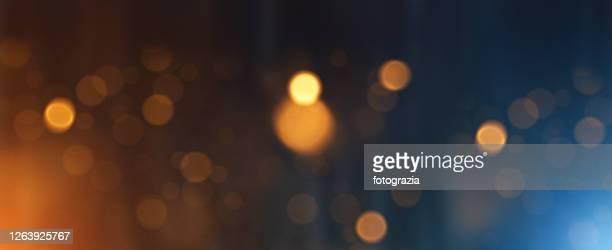 abstract golden defocused lights background - defocussed stock pictures, royalty-free photos & images