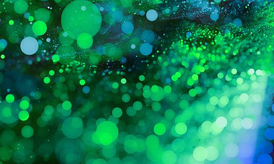 Abstract Green bokeh sparkling spray circle - gettyimageskorea
