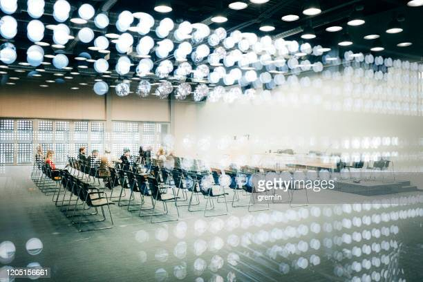 abstract group of business people in the convention center - politics abstract stock pictures, royalty-free photos & images