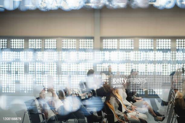 abstract group of business people in the convention center - convention center stock pictures, royalty-free photos & images