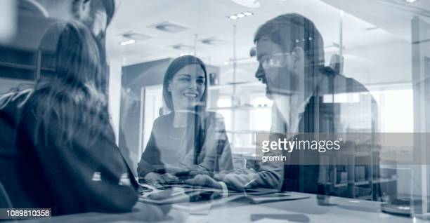abstract group of business people in the meeting - glass magazine stock photos and pictures