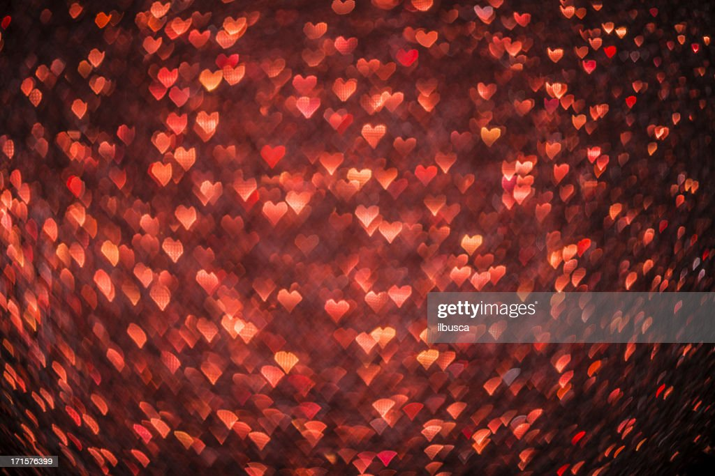 Abstract heart shaped bokeh christmas light red defocussed background : Stock Photo