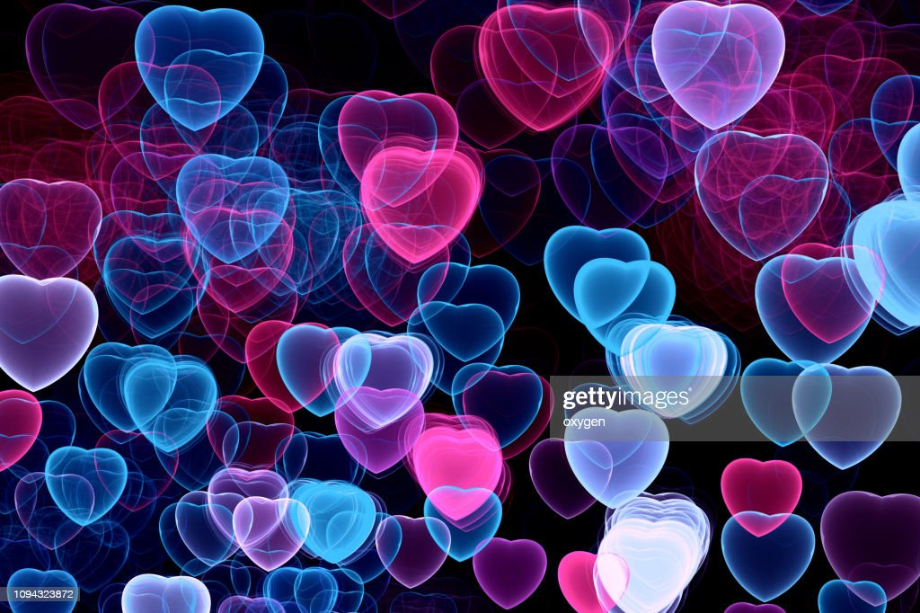 Abstract Hearts bokeh on black background : Stock Photo