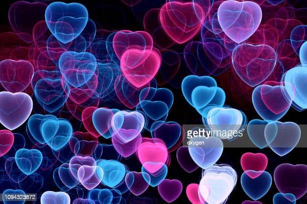 abstract hearts bokeh on black background - heart month stock photos and pictures