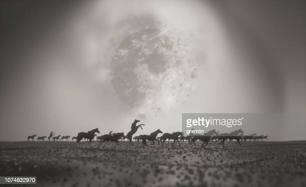 Abstract horses running over fantasy landscape