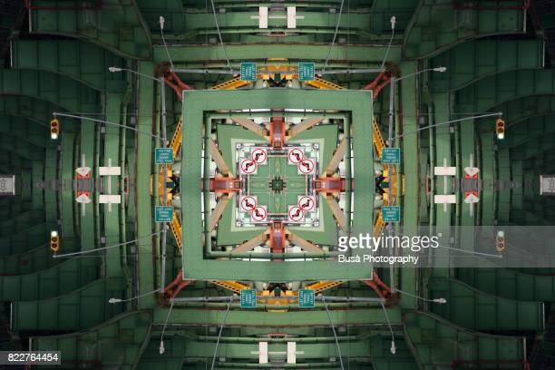 abstract image: kaleidoscopic image of elevated viaduct in brooklyn, new york city - rust colored stock photos and pictures