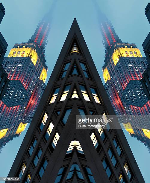 Abstract image: kaleidoscopic image of Empire State Building lights at twilight on a foggy day
