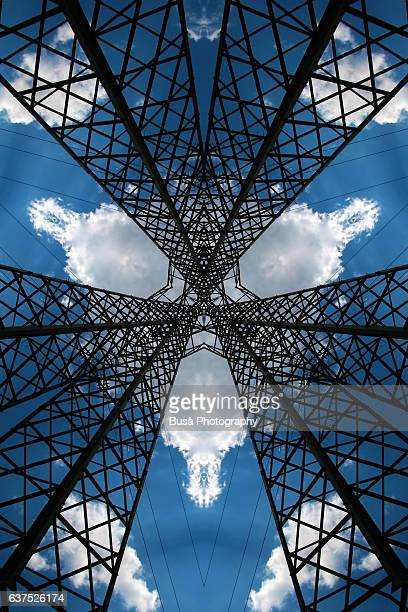 abstract image: kaleidoscopic image of gigantic steel structures against the blue sky - radial symmetry stock pictures, royalty-free photos & images