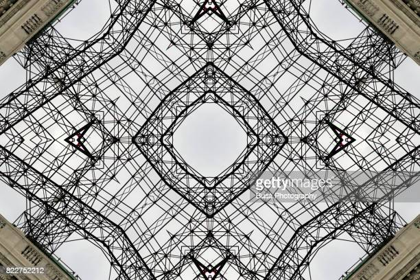 Abstract image: kaleidoscopic image of ornate building with an empty billboard scaffolding on top in Jersey City, New Jersey