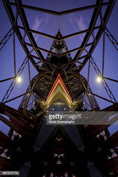 Abstract image: kaleidoscopic image of steel beams of a bridge at night in Berlin, Germany