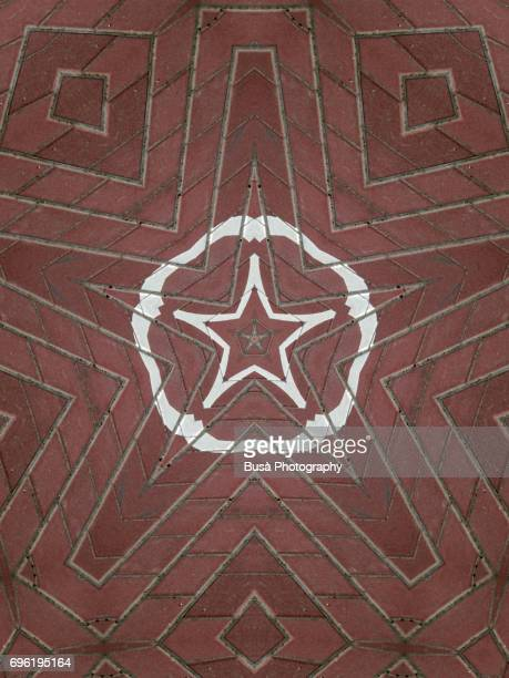 Abstract image: kaleidoscopic image of street tiles with road markings
