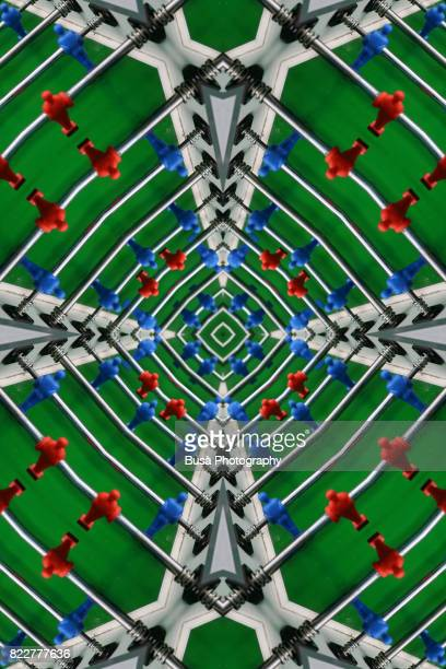 Abstract image: kaleidoscopic image of table football