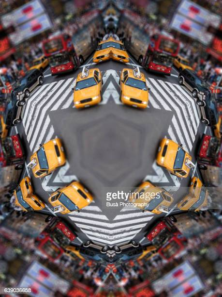 Abstract image: kaleidoscopic image of yellow cabs drivin by crossroad at Times Square, Manhattan, New York City