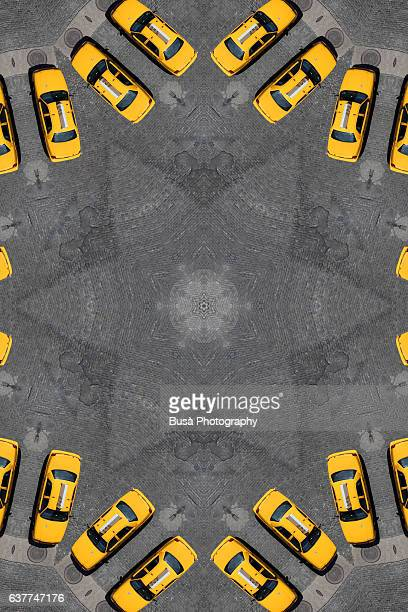 Abstract image: kaleidoscopic image of yellow taxi cabs in the streets of Manhattan, New York City, USA