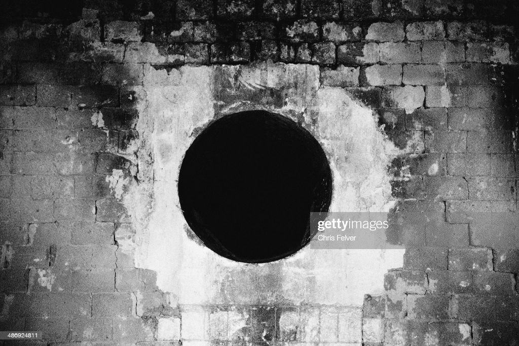 Abstract image of a black hole carved into a brick wall, New York, 2006. From The Ordered World series.
