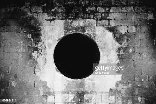 Abstract image of a black hole carved into a brick wall New York 2006 From The Ordered World series