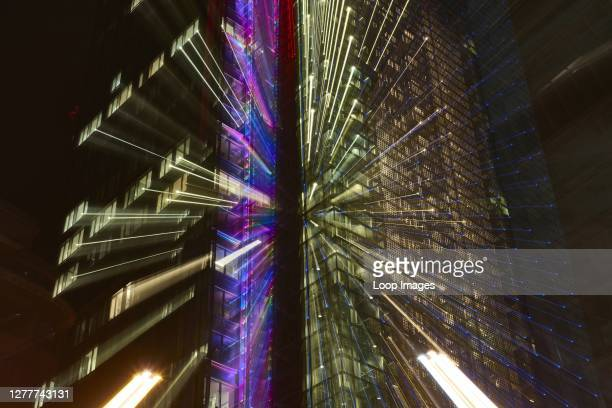 Abstract image of a London building at night with light trails.