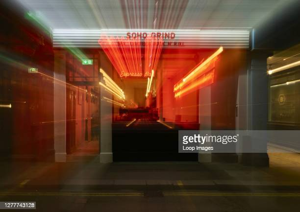 Abstract image of a Soho coffee shop at night with light trails.