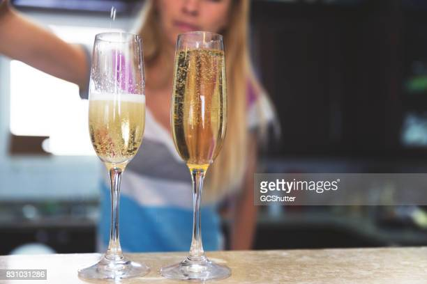 Abstract image of a woman pouring champagne into two flutes