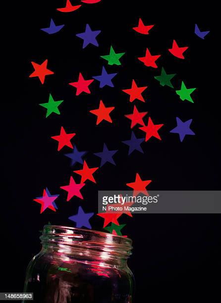 Abstract image of coloured stars streaming from an open glass jar taken on October 12 2011