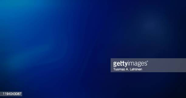 abstract image of curvy, blurred and soft lines or layers on blue background. rippled effect, copy space. dci 4k resolution. - azul fotografías e imágenes de stock
