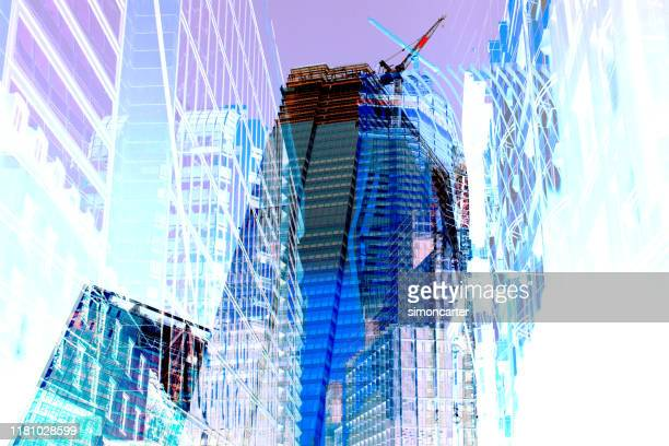 abstract image of office buildings under construction. - economy stock pictures, royalty-free photos & images