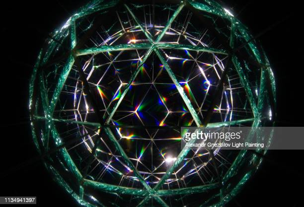 abstract kaleidoscope ball/sphere (light painting) - emerald green stock pictures, royalty-free photos & images