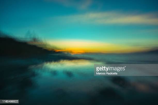 abstract lake and sky background - radicella stock-fotos und bilder