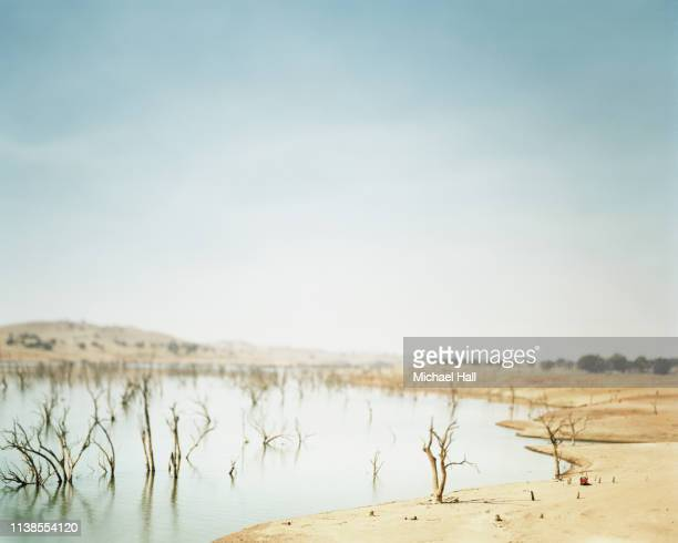 abstract landscape of lake hume under drought - drought stock pictures, royalty-free photos & images
