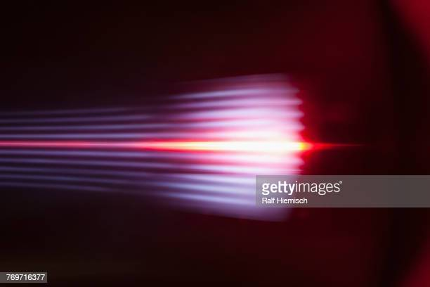 abstract light trails against black background - riflesso foto e immagini stock