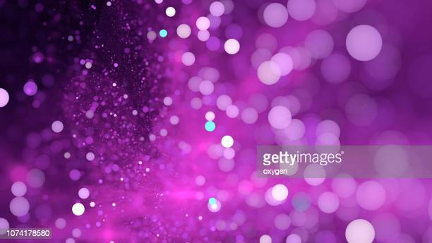 abstract light violet bokeh sparkling spray circle - purple background stock photos and pictures