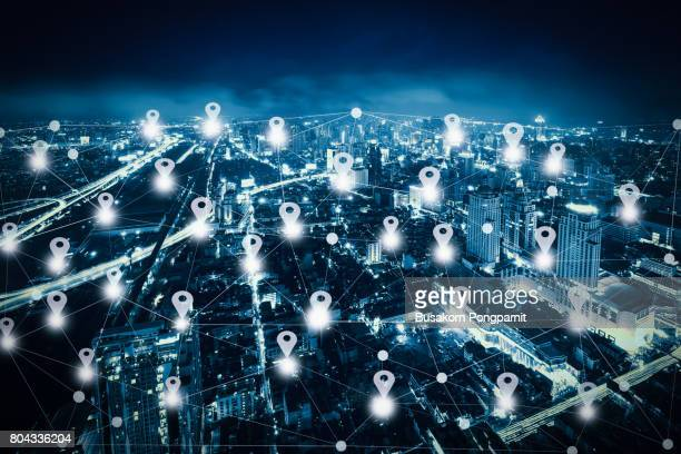 abstract line connection on night cityscape with map pin flat above network connection - building icon stock photos and pictures