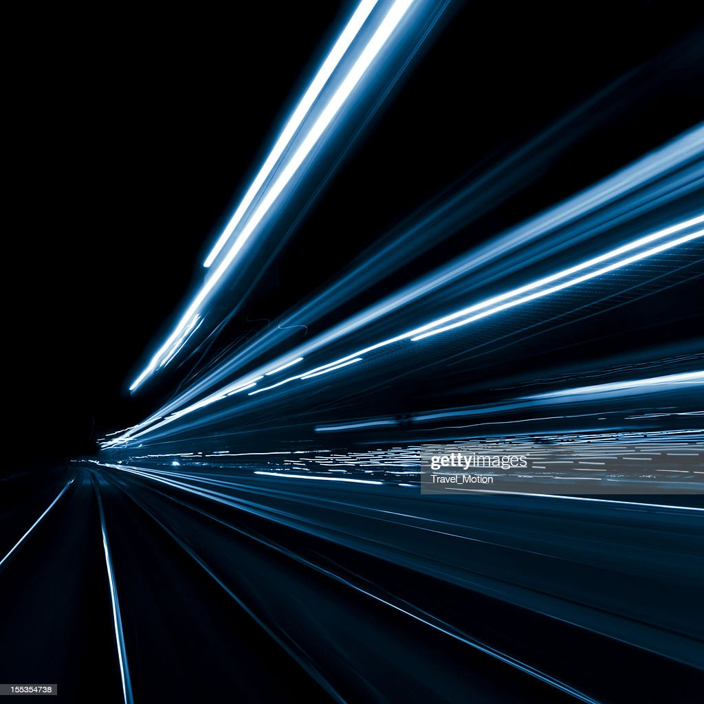 Abstract, long exposure, blue, and blurred city lights : Stock Photo