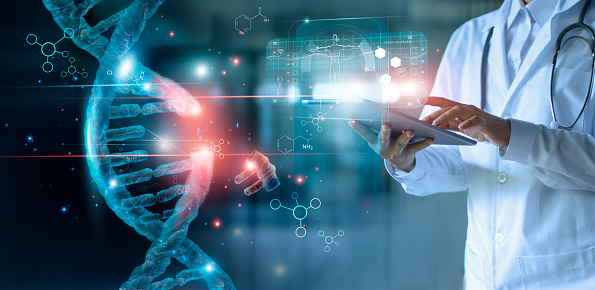 Abstract luminous DNA molecule. Doctor using tablet and check with analysis chromosome DNA genetic of human on virtual interface. Medicine. Medical science and biotechnology. 1150397417