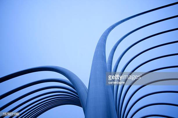 abstract metal tubes with tungsten blue light - sculptuur stockfoto's en -beelden