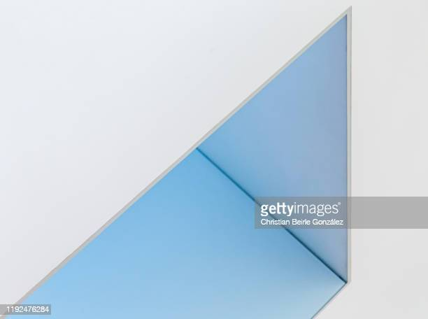 abstract / minimalist capture of a tilted doorframe illuminated in blue. - christian beirle gonzález stock-fotos und bilder