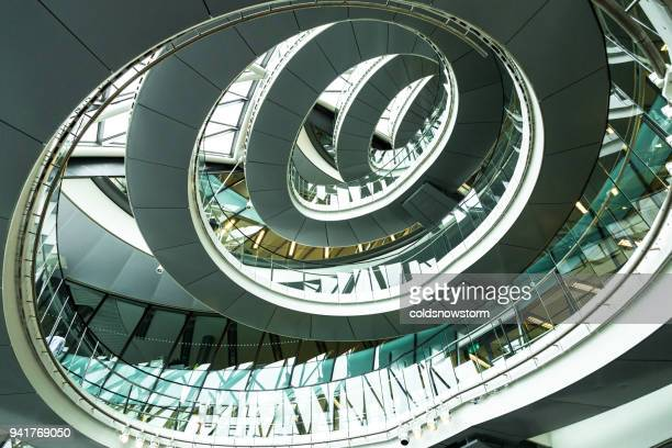 abstract modern architecture and winding staircase in london, uk - town hall government building stock pictures, royalty-free photos & images