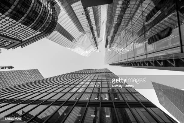abstract modern architecture business buildings in london's financial district in monochrome - stock image - finance stock pictures, royalty-free photos & images