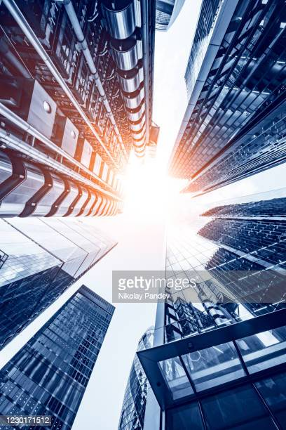 abstract modern business buildings in london city's financial district - creative stock image - micro organism stock pictures, royalty-free photos & images